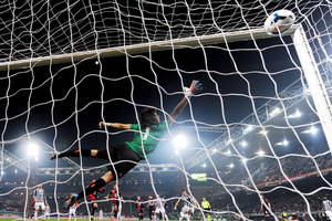 Photo - Juventus' Andrea Pirlo scores during a Serie A soccer match between Genoa and Juventus, at Genoa's Luigi Ferraris Stadium, Italy, Sunday, March 16, 2014. A late Andrea Pirlo goal saw Juventus maintain its charge to a third successive Serie A title as it beat Genoa 1-0 on Sunday to extend its lead to 17 points. Pirlo fired home a stunning free kick two minutes from time as Juventus struggled to a victory after Gianluigi Buffon had saved Emanuele Calaio's penalty for Genoa. (AP Photo/Tano Pecoraro)