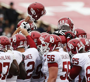 Photo - The OU Sooners gather together before a college football game between the University of Oklahoma (OU) and Texas Tech University at Jones AT&T Stadium in Lubbock, Texas, Saturday, Oct. 6, 2012. OU won, 41-20. Photo by Nate Billings, The Oklahoman