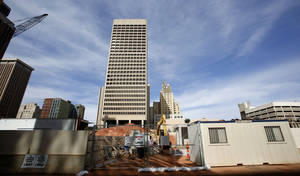 photo - Construction is shown in front of the SandRidge Energy Building on Feb. 8 in Oklahoma City.  Photo By Steve Gooch, The Oklahoman