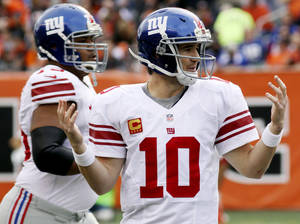 Photo -   New York Giants quarterback Eli Manning (10) holds up his hands after having a pass tipped for an interception in the second half of an NFL football game against the Cincinnati Bengals, Sunday, Nov. 11, 2012, in Cincinnati. (AP Photo/Tom Uhlman)