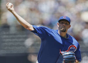Photo - Chicago Cubs starting pitcher Jason Hammel throws against the San Diego Padres during the first inning of a baseball game Sunday, May 25, 2014, in San Diego. (AP Photo/Lenny Ignelzi)