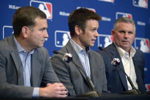 Photo - Chicago White Sox general manager Rick Hahn, left, Los Angeles Angels general manager Jerry Dipoto, center, and Arizona Diamondbacks general manager Kevin Towers address reporters after announcing a trade between the three clubs at baseball's winter meetings in Lake Buena Vista, Fla., Tuesday, Dec. 10, 2013. The Diamondbacks have agreed to acquire outfielder Mark Trumbo from the Angels, with Hector Santiago moving from the White Sox to the Angels, outfielder Adam Eaton from Arizona to Chicago and pitcher Tyler Skaggs from Arizona to Los Angeles. (AP Photo/Phelan M. Ebenhack)