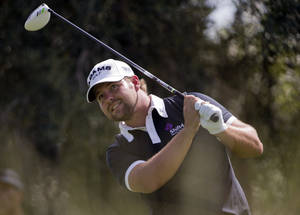 photo -   Ryan Moore tees off on the ninth hole during the first round of the Justin Timberlake Shriners Hospitals for Children Open golf tournament, Thursday, Oct. 4, 2012, in Las Vegas. Moore finished at 10-under par for the round. (AP Photo/Julie Jacobson)