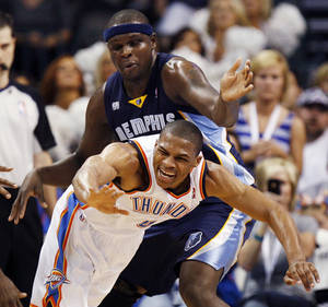 Photo - Oklahoma City's Russell Westbrook (0) gets tripped up in front of Memphis' Zach Randolph (50) during the NBA basketball game between the Memphis Grizzlies and the Oklahoma City Thunder at Chesapeake Energy Arena in Oklahoma City, Monday, April 2, 2012. Memphis 94-88. Photo by Nate Billings, The Oklahoman