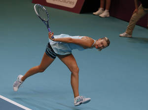 Photo - Maria Sharapova of Russia returns the ball to Anastasia Pavlyuchenkova of Russia during the semi final match of the 22st Gaz de France WTA Open 2014 tennis tournament at Coubertin stadium, in Paris,Saturday, Feb. 1, 2014. (AP Photo/Jacques Brinon)