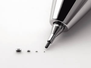 Photo -   In this undated photo released by Murata Manufacturing Co., its latest capacitor, measuring just 0.25 millimeter by 0.125 millimeter, right, is pointed by a mechanical pencil as it is displayed with its bigger size models. Small is big for Murata: The Japanese electronics maker has developed the world's tiniest component known as the capacitor. And that's big business. Capacitors, which store electric energy, are used in the dozens, even in the hundreds, in just about every type of gadget - smartphones, laptops, hybrid cars, medical equipment and digital cameras. (AP Photo/Murata Manufacturing Co.) NO SALES