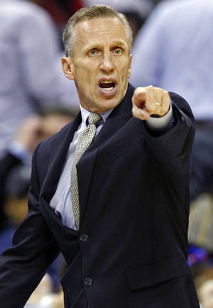 Photo -   Charlotte Bobcats head coach Mike Dunlap directs his team against the Phoenix Suns during the first half of an NBA basketball game in Charlotte, N.C., Wednesday, Nov. 7, 2012. (AP Photo/Chuck Burton)