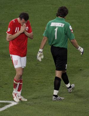 Photo - FILE - In this Monday, June 26, 2006 file photo, Switzerland's Marco Streller, left, reacts after missing a penalty kick against Ukraine's goalkeeper Oleksandr Shovkovskyi, during their World Cup second round soccer match, in Cologne, Germany. Ukraine won 3-0 in a penalty shootout. On this day: Switzerland became the first team in the history of World Cup shoot-outs not to score a single spot kick, and the first team ever to depart a World Cup without conceding a goal in normal play. (AP Photo/Martin Meissner, File)