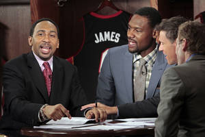 "photo - ESPN ""First Take"" debater Stephen A. Smith (left), makes a point as guest Tony Allen sits in on the set inside a locker room before game two of the NBA basketball finals at the Chesapeake Energy Arena on Thursday, June 14, 2012 in Oklahoma City, Okla.  Photo by Steve Sisney, The Oklahoman <strong>STEVE SISNEY - THE OKLAHOMAN</strong>"