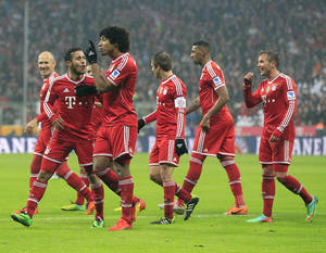Photo - Munich teammates celebrate after scoring during the German first division Bundesliga soccer match between Bayern Munich and Eintracht Frankfurt in Munich, Germany, Sunday, Feb. 2, 2014. (AP Photo/Frank Augstein)
