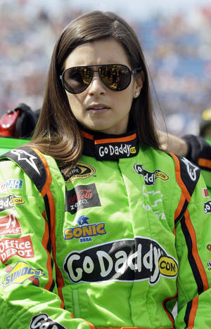 Photo -   Danica Patrick listens to her crew before the NASCAR Sprint Cup Series auto race Geico 400 at Chicagoland Speedway in Joliet, Ill., Sunday, Sept. 16, 2012. (AP Photo/Nam Y. Huh)