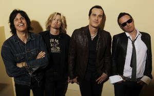 "Photo - FILE - This April 30, 2010 file photo shows the Stone Temple Pilots, from left, Dean Deleo, Eric Kretz, Robert Deleo, and Scott Weiland from the band Stone Temple Pilots, pose for a portrait in Santa Monica, Calif. In a one-sentence news release on Wednesday, Feb. 27, 2013, publicist Kymm Britton said: ""Stone Temple Pilots have announced they have officially terminated Scott Weiland."" No other information was provided. (AP Photo/Matt Sayles, file)"