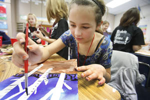 Photo - Shelby Johnson, above, and Tim Budd, at right, paint during fourth grade art class at Orvis Risner Elementary School in Edmond.  Photos By Steve Gooch,  The Oklahoman