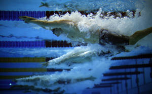 Photo -   Athletes compete in the men's 200m Individual Medley SM10 category at the 2012 Paralympics Olympics, Thursday, Aug. 30, 2012, in London. (AP Photo/Emilio Morenatti)