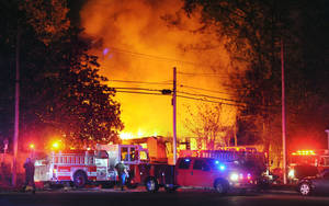 Photo -   Flames and smoke billow from a home in west Jackson, Miss., Tuesday evening, Nov. 13, 2012, after authorities say a small plane carrying three people crashed into the residence shortly after 5 p.m. (AP Photo/The Clarion-Ledger, Joe Ellis) NO SALES