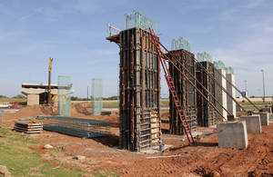 Photo -  Columns are going up to form an elevated connection between Interstate 40 south of Lower Bricktown and the future downtown boulevard. Photos by Nate Billings, The Oklahoman  <strong>NATE BILLINGS -   </strong>