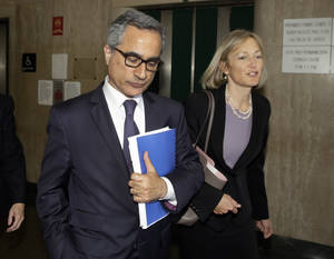 Photo - BNP Paribas general counsel Georges Dirani, accompanied by attorney Karen Patton Seymour, leaves New York state Supreme Court, in New York, Monday, June 30, 2014. France's largest bank, BNP Paribas, pleaded guilty Monday and agreed to pay nearly $9 billion to resolve criminal allegations that it processed transactions for clients in Sudan and other blacklisted countries in violation of U.S. trade sanctions. (AP Photo/Richard Drew)