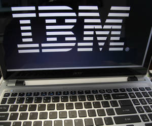 Photo - FILE - In this Tuesday, July 16, 2013, file photo, an IBM logo is displayed in Berlin, Vt.  The company reports quarterly earnings on Tuesday, Jan. 21, 2014. (AP Photo/Toby Talbot, File)
