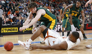 photo - Baylor's Josh Lomers (50) and Texas' Dexter Pittman (34) battle for a loose ball in the semifinal game of the Big 12 Men's Basketball Championships between The University of Baylor and The University of Texas at the Ford Center on Friday, March 13, 2009, in Oklahoma City, Okla.