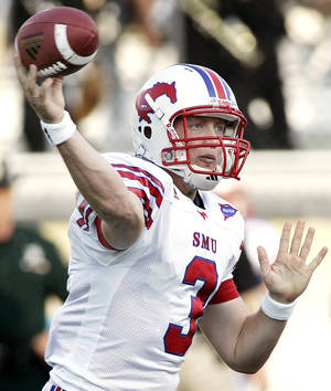 Photo - SMU quarterback Bo Levi Mitchell is learning on the job. AP photo
