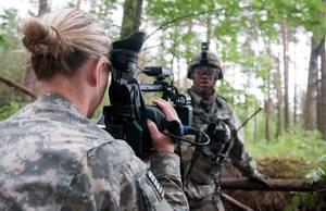 Photo -  SecondLt. Leanna Litsch, of Altus, interviews a soldier in Rukla, Lithuania, on June 14. Litsch belongs to the 145th Mobile Public Affairs Detachment, which was sent to four countries to tell the story of the 173rd Airborne Brigade and their training in the Baltic region. PHOTO BY SGT. DANIEL NELSON, OKLAHOMA ARMY NATIONAL GUARD  <strong>Sgt. Daniel Nelson -  Sgt. Daniel Nelson, 145 MPAD, Oklahoma Army National Guard </strong>
