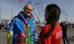 Photo - Sochi 2014 Organizing Committee President Dmitry Chernyshenko, left, talks to a Russian fan during a tour of Olympic Park at the 2014 Winter Olympics, in Sochi, Russia on Thursday, Feb. 20, 2014. (AP Photo/Ben Jary)