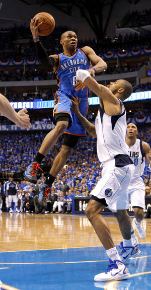 Photo - Oklahoma City's Russell Westbrook (0) tries ti get past Tyson Chandler (6) of Dallas during game 1 of the Western Conference Finals in the NBA basketball playoffs between the Dallas Mavericks and the Oklahoma City Thunder at American Airlines Center in Dallas, Tuesday, May 17, 2011. Photo by Bryan Terry, The Oklahoman