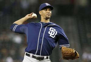 Photo - San Diego Padres' Tyson Ross throws against the Arizona Diamondbacks during the fourth inning of a baseball game on Monday, Aug. 26, 2013, in Phoenix. (AP Photo/Ross D. Franklin)