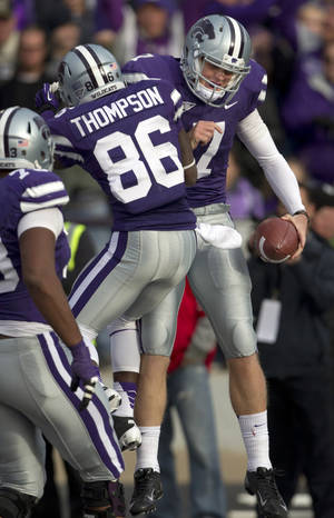 Photo -   Kansas State quarterback Collin Klein (7) celebrates a touchdown with wide receiver Tramaine Thompson (86) during the second half of an NCAA college football game against Texas Tech in Manhattan, Kan., Saturday, Oct. 27, 2012. (AP Photo/Orlin Wagner)
