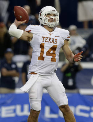 Photo - Texas quarterback David Ash (14) passes the ball in the first quarter during an NCAA college football game against Brigham Young Saturday, Sept. 7, 2013, in Provo, Utah. (AP Photo/Rick Bowmer)