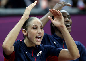 Photo -   USA's Diana Taurasi cheers for teammates during a preliminary women's basketball game against China at the 2012 Summer Olympics, Sunday, Aug. 5, 2012, in London. (AP Photo/Eric Gay)
