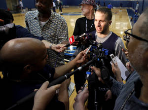 photo - JOSE BAREA: Jose Juan Barea  of Dallas talks with the media after practice for game 2 of the Western Conference Finals in the NBA basketball playoffs between the Dallas Mavericks and the Oklahoma City Thunder at American Airlines Center in Dallas, Wednesday, May 18, 2011. Photo by Bryan Terry, The Oklahoman ORG XMIT: KOD