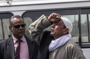 Photo - The father of one of the victims who was killed inside a police van cries after the verdict was announced convicting four Egyptian police officers for the killings last summer of 37 Islamist detainees, outside the Police Academy Court, Cairo, Egypt, Tuesday, March 18, 2014. The detainees, most of them supporters of ousted President Mohammed Morsi, died while being transported in a prison truck on Aug. 18, 2013 reportedly suffocating to death after tear gas was fired into the vehicle. Lawyers and families denounced the verdict and light sentences, saying the police should have been tried for murder instead of manslaughter charge. The gruesome incident drew condemnation from rights groups and the international community. (AP Photo/El Shorouk newspaper, Roger Anis) EGYPT OUT