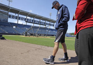Photo - New York Yankees shortstop Derek Jeter, who is on the disabled list, walks gingerly on the field after doing an interview before the Yankees' spring training baseball game at Steinbrenner Field in Tampa, Fla., Tuesday, March 26, 2013. (AP Photo/Kathy Willens)