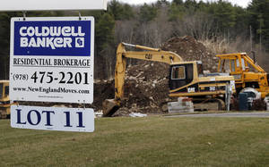 photo - In this Thursday, Dec. 20, 2012 photo, a sign hangs in North Andover, Mass., where a house is under construction. Sales of new U.S. homes cooled off in December compared with November, but sales for the entire year were the best since 2009. The Commerce Department said Friday, Jan. 25, 2013, that new-home sales fell 7.3 percent last month to a seasonally adjusted annual rate of 369,000. That's down from November's rate, which was the fastest in 2 ½ years. (AP Photo/Elise Amendola)