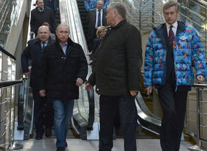 Photo - Russian President Vladimir Putin, foreground left, and Railways Chief Vladimir Yakunin, second right, visit the Olympic Park railway station at the Black Sea resort of Sochi, southern Russia, Saturday, Jan. 4, 2014. Russian President Vladimir Putin has rescinded a blanket ban on demonstrations in Sochi in and around the Winter Olympics and Paralympics. (AP Photo/RIA-Novosti, Alexei Nikolsky, Presidential Press Service)