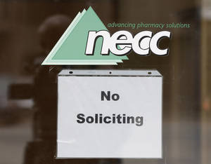 "Photo -   FILE - In this Oct. 4, 2012 file photo, a sign requesting ""No Soliciting"" hangs on the door of New England Compounding in Framingham, Mass. The New England Compounding Center and its practices are under scrutiny as investigators try to determine how a steroid solution supplied by the pharmacy apparently became contaminated with a fungus. The drug has sickened more than 180 people in 12 states, killing 14. Most of the patients had received spinal injections of the steroid for back pain. (AP Photo/Stephan Savoia)"