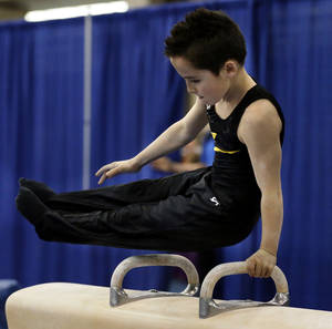 Photo - Kaden Bowling, 9, from Springfield, Mo. competes on the pommel horse at the Bart Connor Invitational Sports Festival on Saturday, Feb. 16, 2013  in Oklahoma City, Okla. Photo by Steve Sisney, The Oklahoman