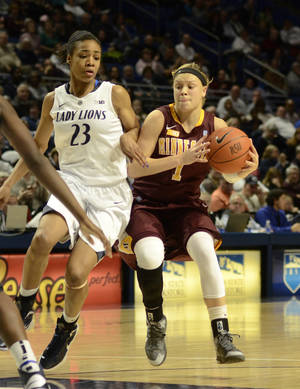 photo - Minnesota's Rachel Banham (1) works past Penn State's Ariel Edwards (23) during the second half of an NCAA college basketball game in State College, Pa., Thursday, Jan. 24, 2013. Penn State won 64 -59. (AP Photo/Ralph Wilson)