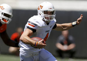 Photo - OKLAHOMA STATE UNIVERSITY / OSU / COLLEGE FOOTBALL: OSU's J.W. Walsh scrambles during Oklahoma State's spring football game at Boone Pickens Stadium in Stillwater, Okla., Saturday, April 21, 2012. Photo by Bryan Terry, The Oklahoman