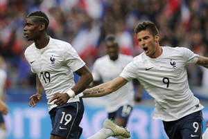 Photo - Paul Pogba of France, left, and Olivier Giroud celebrate a goal during the friendly soccer match between France and Norway at the Stade de France stadium in Saint Denis, outside Paris, Tuesday, May 27, 2014. France are preparing for the upcoming soccer World Cup in Brazil starting on 12 June. (AP Photo/Christophe Ena)