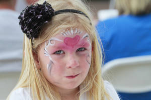 photo - Austyn Langley, 4, had her face painted at the Edmond Arts Festival.