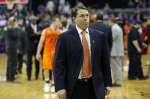 photo - Oklahoma State head coach Travis Ford walks off the court following the Cowboys' loss at the Phillips 66 Big 12 Men's basketball championship tournament game between Oklahoma State University and Kansas State at the Sprint Center in Kansas City, Friday, March 15, 2013. Photo by Sarah Phipps, The Oklahoman