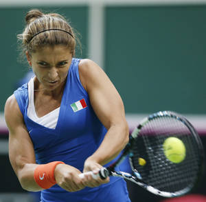 Photo - Italy's Sara Errani returns a ball to Czech Republic's Lucie Safarova during the Fed Cup semifinals in Ostrava, Czech Republic, Saturday, April 19, 2014. (AP Photo/Petr David Josek)