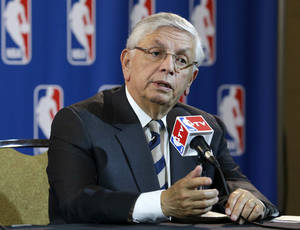 Photo - NBA Commissioner David Stern takes a question from a reporter during a news conference following an NBA Board of Governors meeting Wednesday, May 15, 2013, in Dallas. NBA owners voted Wednesday to reject the Sacramento Kings' proposed move to Seattle, the latest in a long line of cities that have tried to land the franchise.   (AP Photo/Tony Gutierrez)