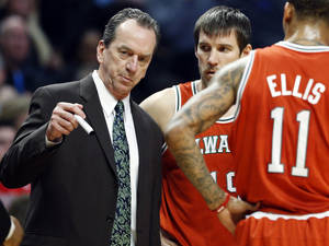 Photo - Milwaukee Bucks head coach Jim Boylan, left, talks to his team during the first half of an NBA basketball game against the Chicago Bulls in Chicago, Wednesday, Jan. 9, 2013. (AP Photo/Nam Y. Huh)