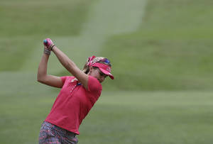 Photo - Lexi Thompson of the US prepares to hit a tee shot during her third round at the Malaysian LGPA event in Kuala Lumpur, Saturday, Oct. 12, 2013. (AP Photo/Mark Baker)