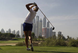 Photo - Stacy Lewis of the U.S. tees off on the 8th hole during the 3rd round of Dubai Ladies Masters golf tournament in Dubai, United Arab Emirates, Friday, Dec. 6, 2013. (AP Photo/Kamran Jebreili)