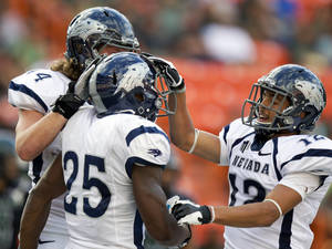 Photo -   Nevada's Zach Sudfeld, left, and teammate Richy Turner (12) congratulate running back Stefphon Jefferson (25) after his scoring a touchdown against Hawaii in the first quarter of an NCAA college football game, Saturday, Sept. 22, 2012, in Honolulu. (AP Photo/Eugene Tanner)