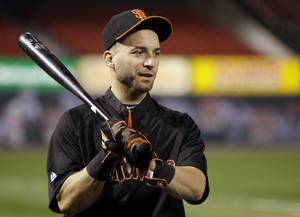 photo -   San Francisco Giants second baseman Marco Scutaro holds a bat during baseball practice, Tuesday, Oct. 16, 2012, in St. Louis. The Giants are scheduled to play the St. Louis Cardinals in Game 3 of baseball's National League championship series Wednesday in St. Louis. (AP Photo/Jeff Roberson)